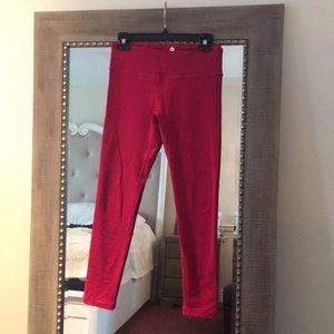 Full length dark pink colored leggings